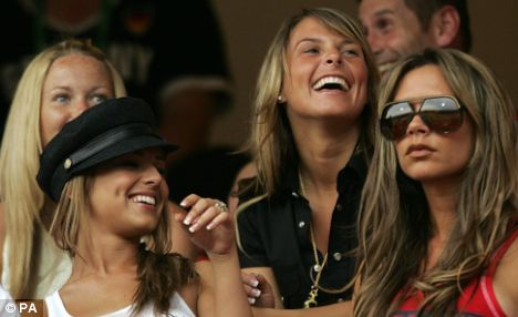 Famous WAGs Cheryl Cole, partner of Ashley Cole, Coleen McLoughlin, wife of Wayne Rooney and Victoria Beckham, wife of David Beckham, at the FIFA World Cup